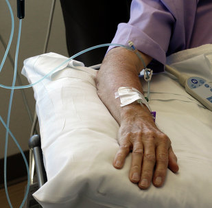 Chemotherapy is administered to a cancer patient.