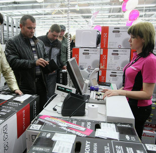 Buyers at a cashier in the consumer electronics store Media Markt in Novosibirsk