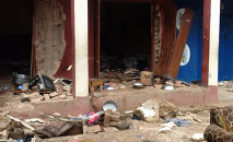 Debris lays strewn over the area after a bomb exploded at a mosque in Jos, Nigeria