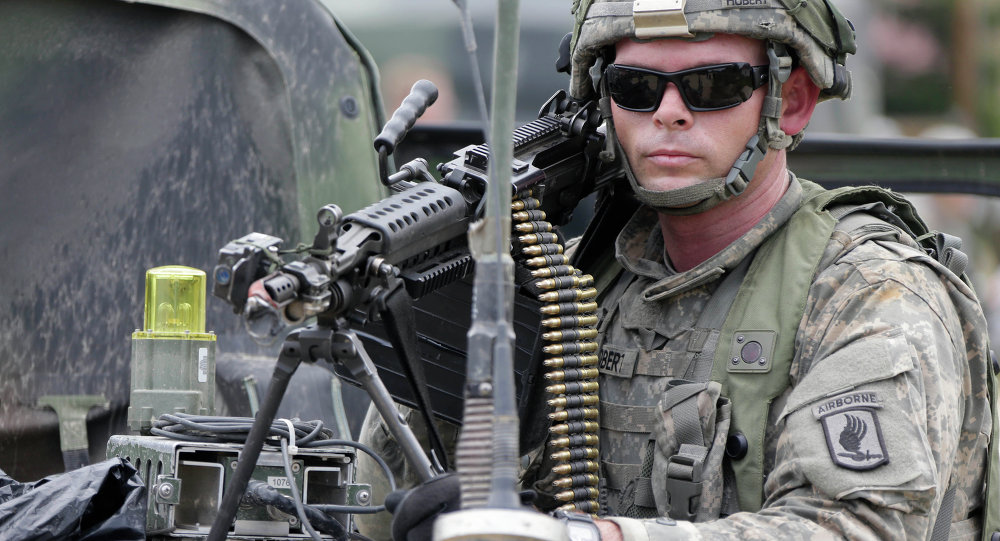 A US soldier takes part in an exercise called Saber Junction at the military area in Hohenfels near Regensburg, southern Germany, Monday, Sept. 8, 2014