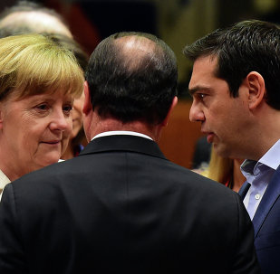 (From L) German Chancellor Angela Merkel, French President Francois Hollande, and Greek Prime Minister Alexis Tsipras confer prior to the start of a summit of Eurozone heads of state in Brussels on July 12, 2015.