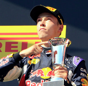 Second placed Red Bull Formula One driver Daniil Kvyat of Russia points to his cup after the Hungarian F1 Grand Prix at the Hungaroring circuit, near Budapest, Hungary July 26, 2015