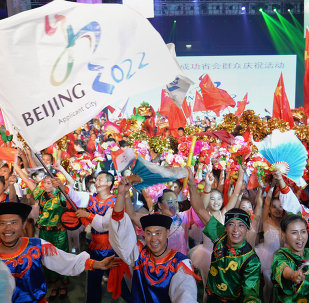 Chinese people wearing traditional costumes gather to celebrate as Beijing is announced as the host city for the 2022 Winter Olympic Games, in Shijiazhuang, the capital of northern China's Hebei province on July 31, 2015.