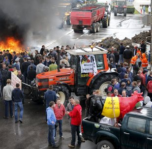 Belgian dairy farmers block the access to the milk processing factory Corman during a protest against low milk prices in Bethane near Liege, Belgium