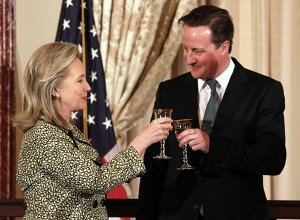 Secretary of State Hillary Rodham Clinton makes a toast with British Prime Minister David Cameron during a luncheon at the State Department in Washington, Wednesday, March 14, 2012.