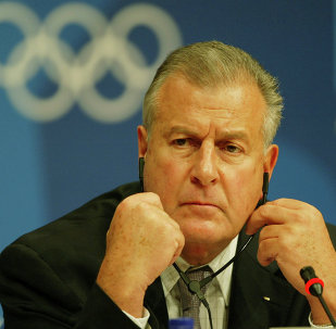 IOC legal advisor Francois Carrard listens to a question, during a press conference in Athens, Wednesday Aug. 18, 2004, concerning Greek sprinters Kostas Kenteris and Katerina Thanou