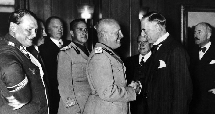 From left to right are: Reichsmarschall and President of the Reichstag Hermann Goering, Italian Foreign Minister Count Ciano and Italian Fascist Leader Benito Mussolini shaking hands with Prime Minister of Great Britain Neville Chamberlain during the Four Power Conference held in autumn 1938 in Munich, Germany. Others not identified