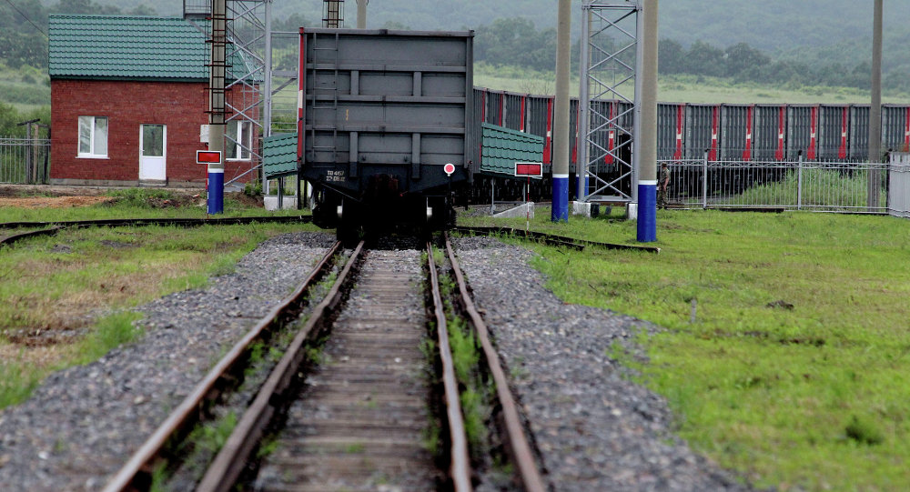 The first freight train crosses the new railway checkpoint between the Russian station Makhalino and Chinese station Hunchun, Jilin province