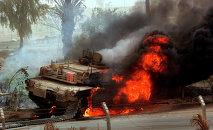 Huge flames come out of a US Abrams battle tank.