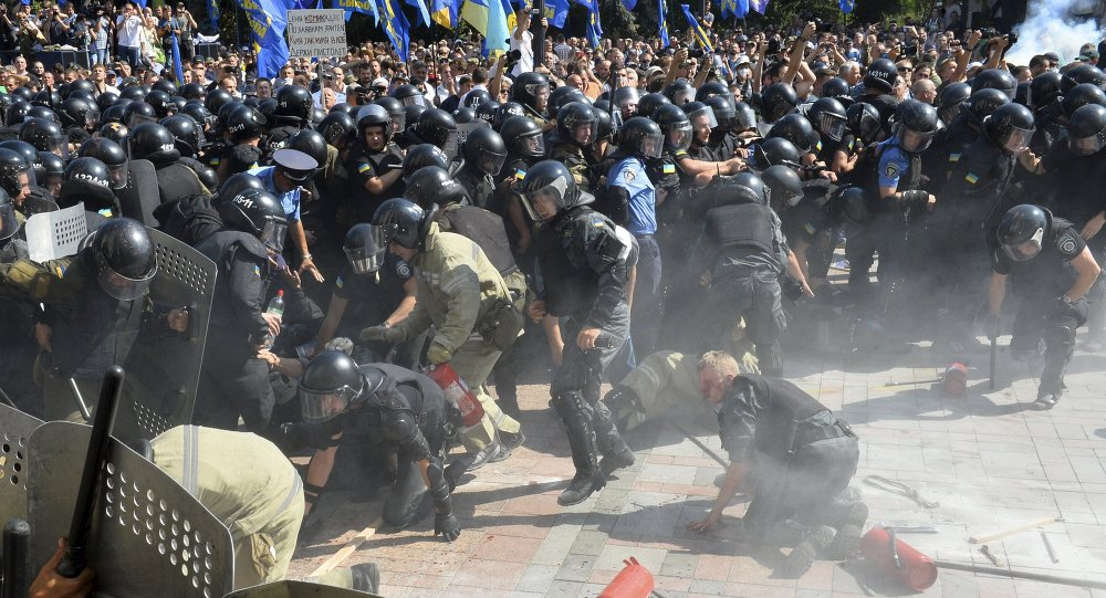 Injured police officers scream in pain as they fall, shortly after an explosion outside the parliament building in Kiev, Ukraine, August 31, 2015
