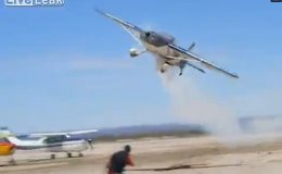 Idiot gets in the way of aerobatic airplane