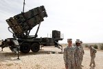 US soldiers stand beside a US Patriot missile system at a Turkish military base in Gaziantep, southeastern Turkey, in this October 10, 2014, photo