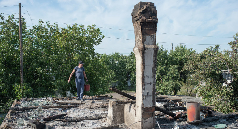 A man in the village of Oleksandrivka, Donetsk Region where houses were destroyed and people wounded during a mortar shelling.