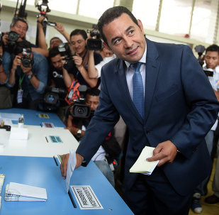 Guatemalan presidential candidate for the National Front of Convergence (FCN) party, Jimmy Morales, casts his vote at a polling station in Mixco, 19 km from Guatemala City, during general elections on September 6, 2015