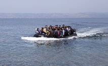 Afghan refugees arrive on a dinghy on the Greek island of Lesbos, September 9, 2015.