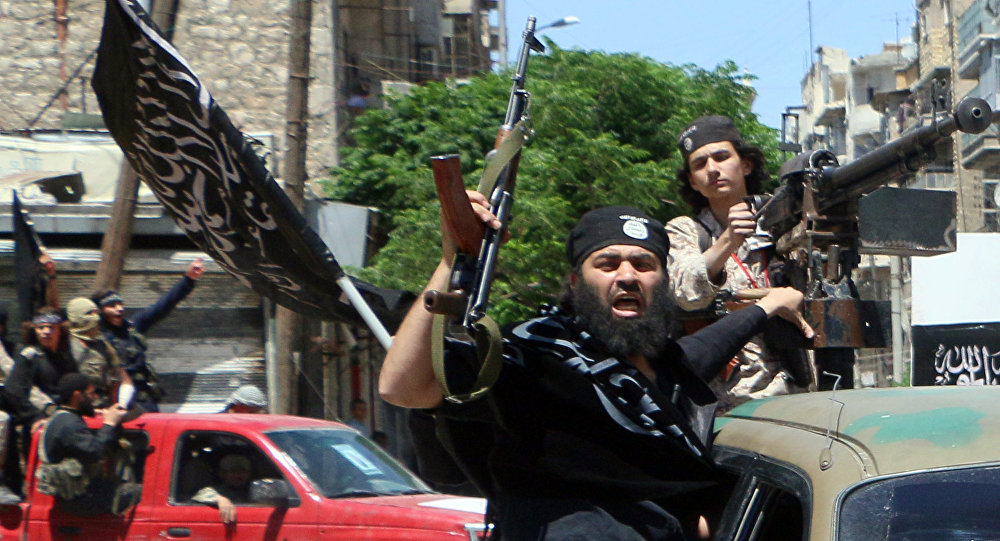 Fighters from Al-Qaeda's Syrian affiliate Al-Nusra Front drive in the northern Syrian city of Aleppo.