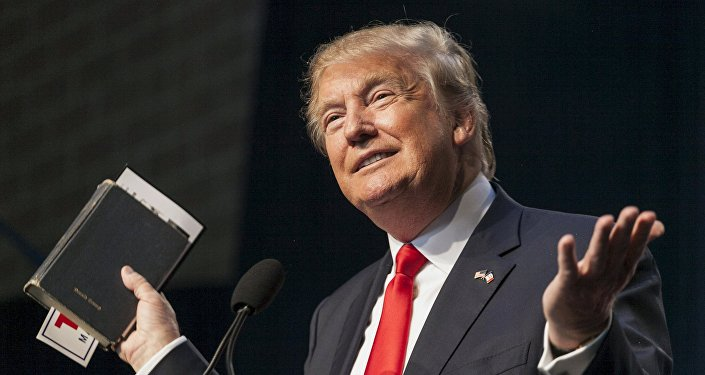 US Republican presidential candidate Donald Trump holds his bible while speaking at the Iowa Faith and Freedom Coalition Forum in Des Moines, Iowa, September 19, 2015