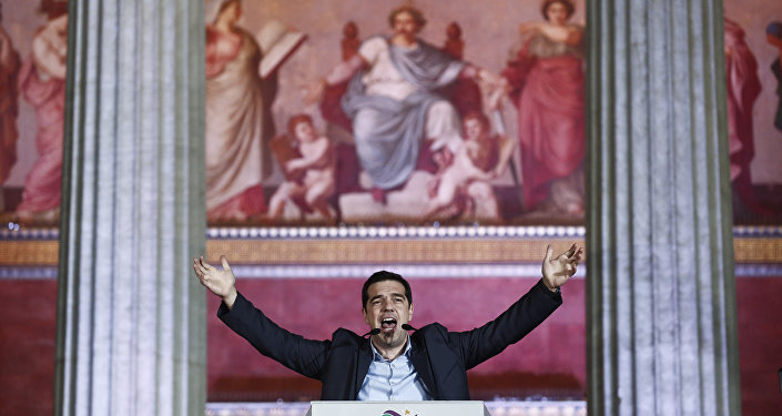 Leader of Syriza left-wing party Alexis Tsipras speaks to his supporters outside Athens University Headquarters, Sunday, Jan. 25, 2015.