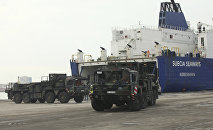 German military trucks carrying NATO's Patriot Missile Defense System to protect Turkey in case neighboring Syria launches an attack leave the port after the parts of system were unloaded in the Mediterranean city of Iskenderun, Turkey