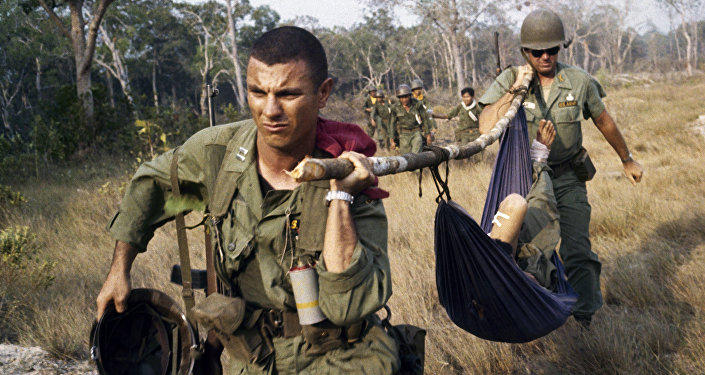 U. S. soldier giving first aid to the wounded in Vietnam in 1968