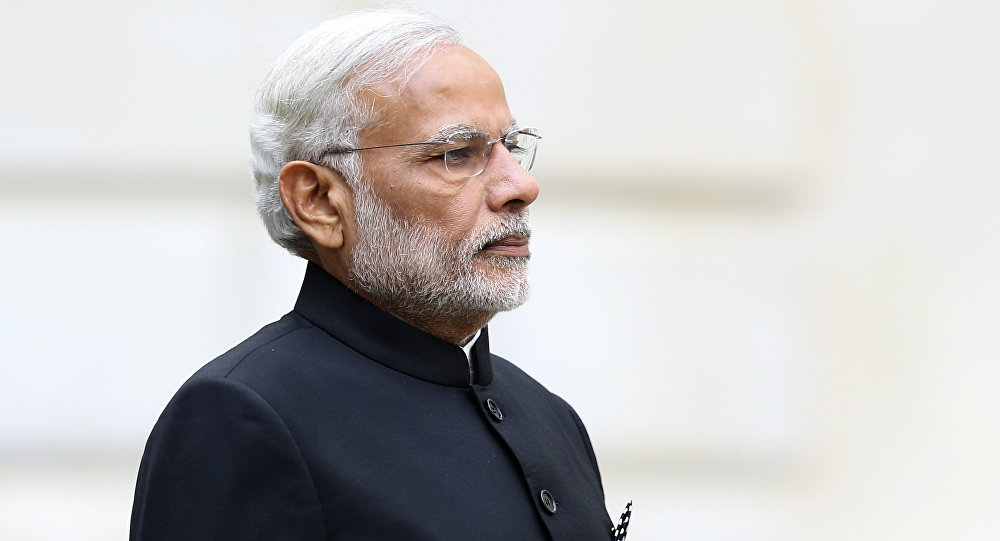 Indian Prime Minister Narendra Modi stands during a welcome ceremony outside the Treasury in London on November 12, 2015 on the first day of a three-day visit to Britain.