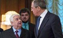 Russian Foreign Minister Sergei Lavrov (right) and Syrian Minister of Foreign Affairs and Expatriates Walid al-Muallem during a meeting at the Foreign Ministry Reception House