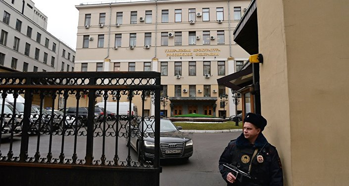 A police officer at the Prosecutor-General's Office in Bolshaya Dmitrovka Street, Moscow