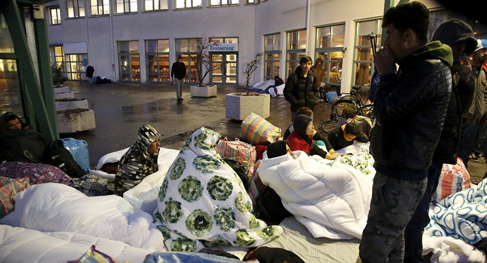 Refugees sleep outside the entrance of the Swedish Migration Agency's arrival center for asylum seekers at Jagersro in Malmo, Sweden, November 20, 2015