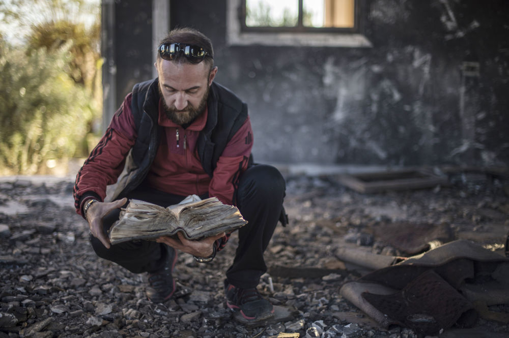 The remains of ancient Christian books burnt by Daesh militants, found in the ruins of St. George's Church in Al-Hasakah province of Syria.