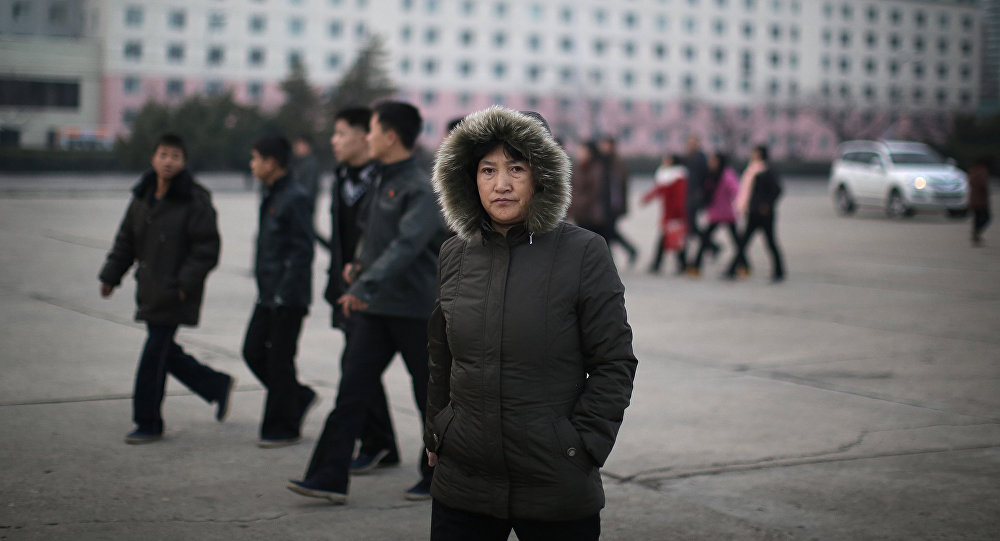 A North Korean woman walks down the streets of Pyongyang, North Korea on Tuesday, Dec. 1, 2015 where the winter season has started