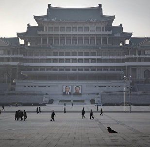 North Koreans walk along the Kim Il Sung Square as they commute at the end of their work day, Monday, Nov. 30, 2015, in Pyongyang, North Korea