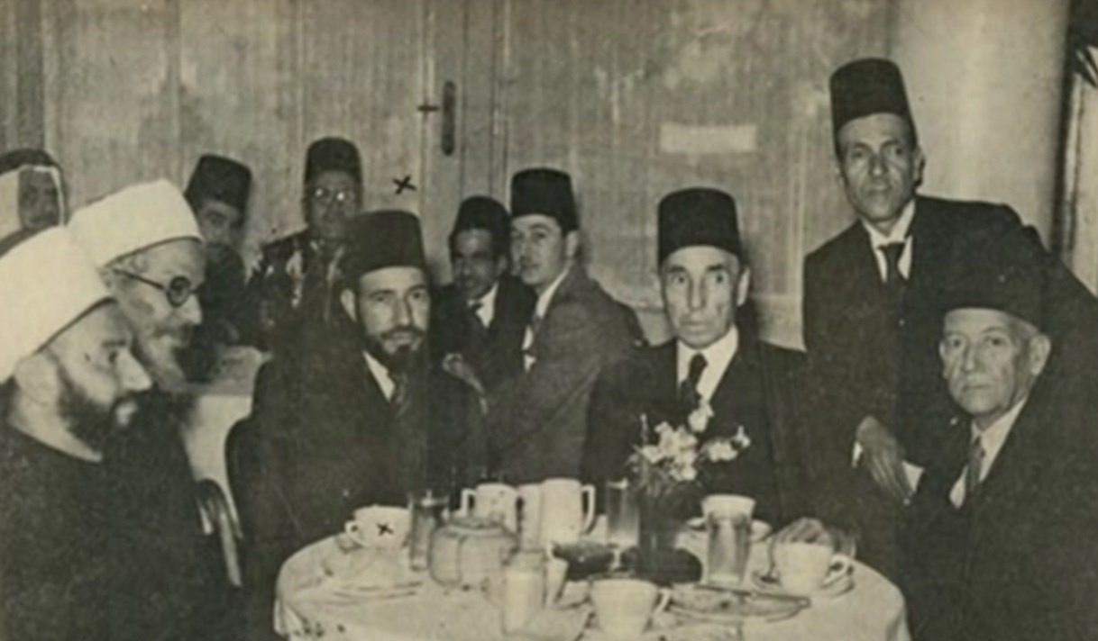 Al-Banna (third from left) with Aziz Ali al-Misri (fourth from right) and Egyptian, Palestinian and Algerian political and religious figures at a reception in Cairo, 1947.