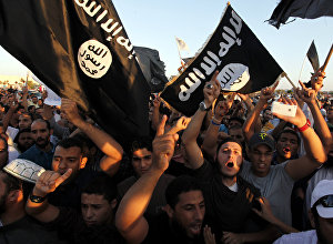 In this Friday, Sept. 21, 2012 file photo, Libyan followers of Ansar al-Shariah Brigades and other Islamic militias, hold a demonstration against a film and a cartoon denigrating the Prophet Muhammad in Benghazi