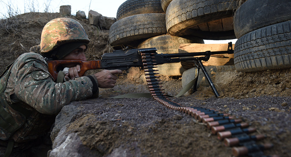 A picture taken on February 16, 2015 shows an Armenian serviceman guarding an area near the village of Movses, close to the border with Azerbaijan