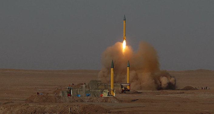 In this picture released by the Iranian Fars News Agency, asurface-to-surface missile is launched during the Iranian Revolutionary Guards maneuver in an undisclosed location in Iran, Tuesday, July 3, 2012