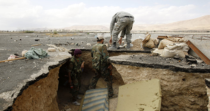 Syrian government forces get out of a tunnel, reportedly previously used by rebel fighters after they took control of Adra al-Balad city on the outskirts of the capital Damascus. File photo.