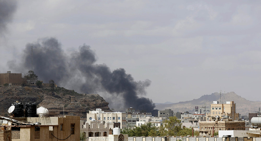 Smoke rises after a Saudi-led airstrike hit a site in Yemen
