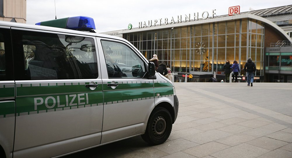 A police vehicle patrols at the main square and in front of the central railway station in Cologne, Germany, January 5, 2016.