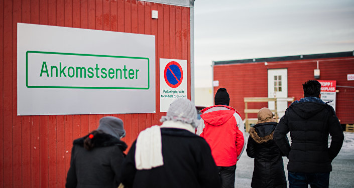 Refugees enter the arrival center for refugees near the town on Kirkenes, northern Norway, close to the Russian - Norwegian border.