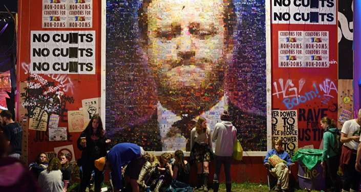 A large mural depicting British Prime Minster David Cameron is displayed in the Hell section of the Shangri La area of the Glastonbury Festival