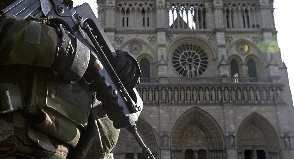 An armed French soldier patrols in front of Notre Dame Cathedral in Paris, France, in this picture taken on December 24, 2015, as a security alert continued following the November shooting attacks in the French capital. Thousands of demonstrators marched in France January 30, 2016 to protest against the government's plans to extend the state of emergency in the country. Picture taken December 24, 2015.
