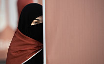 A Bahraini woman takes part in an anti-government protest that marks a 1000 days since the Shiite-led uprising demanding democratic reforms in Sunni-ruled but Shiite-majority Bahrain, in the village of al-Shakhurah, west of Manama, on December 13, 2013.