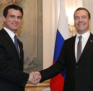 Russian Prime Minister Dmitry Medvedev, right, and French Prime Minister Manuel Valls meet on the sidelines of the Security Conference in Munich, Germany, Saturday, Feb. 13, 2016