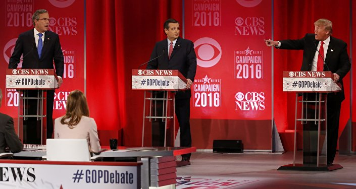 Republican U.S. presidential candidates former Governor Jeb Bush (L) and businessman Donald Trump (R) speak simultaneously about the war in Iraq and the record of Bush's brother, former President George W. Bush, as Senator Ted Cruz (C) looks on during the Republican U.S. presidential candidates debate sponsored by CBS News and the Republican National Committee in Greenville, South Carolina February 13, 2016.