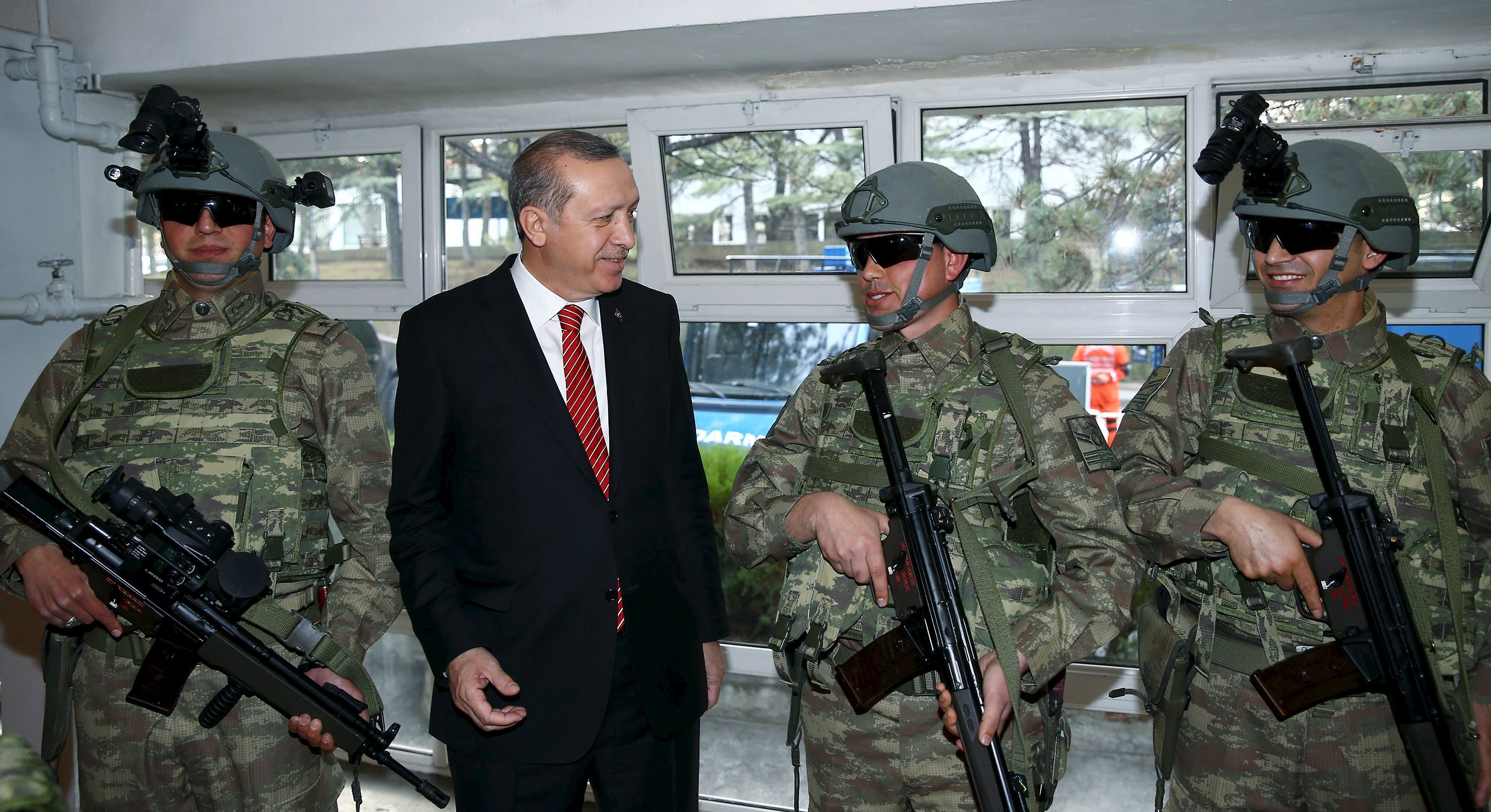 Turkish President Tayyip Erdogan (2nd L) speaks with commandos during his visit at the Gendarmerie Commando Special Forces headquarters in Ankara, Turkey February 16, 2016