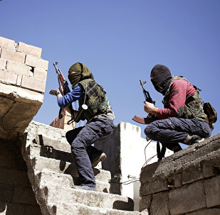 Militants from the Kurdistan Workers' Party, or PKK, run as they attack Turkish security forces in Nusaydin, Turkey, Tuesday, March 1, 2016