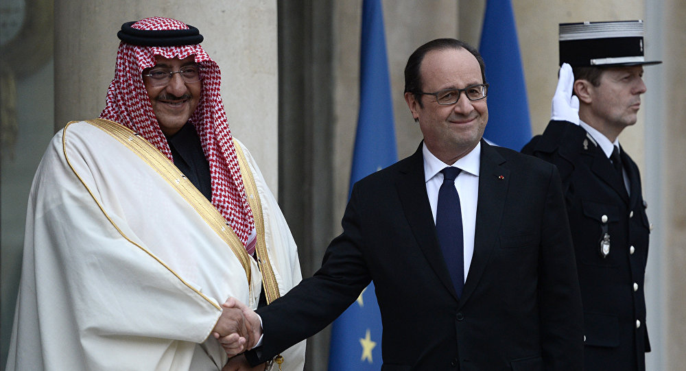 French President Francois Hollande (R) greets Saudi Crown Prince Mohammed bin Nayef upon his arrival for their talks on March 4, 2016 at the Elysee Presidential Palace in Paris