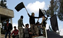 Protesters carry Nusra Front flags and shout slogans during an anti-government protest after Friday prayers in the town of Marat Numan in Idlib province, Syria, March 11, 2016