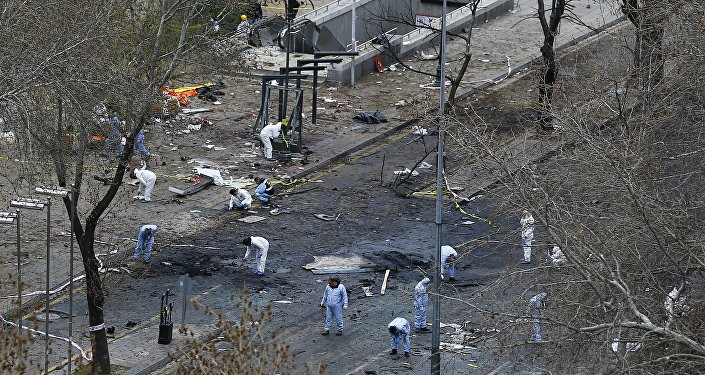 Forensic officers work on the site of a suicide bomb attack in Ankara, Turkey March 14, 2016