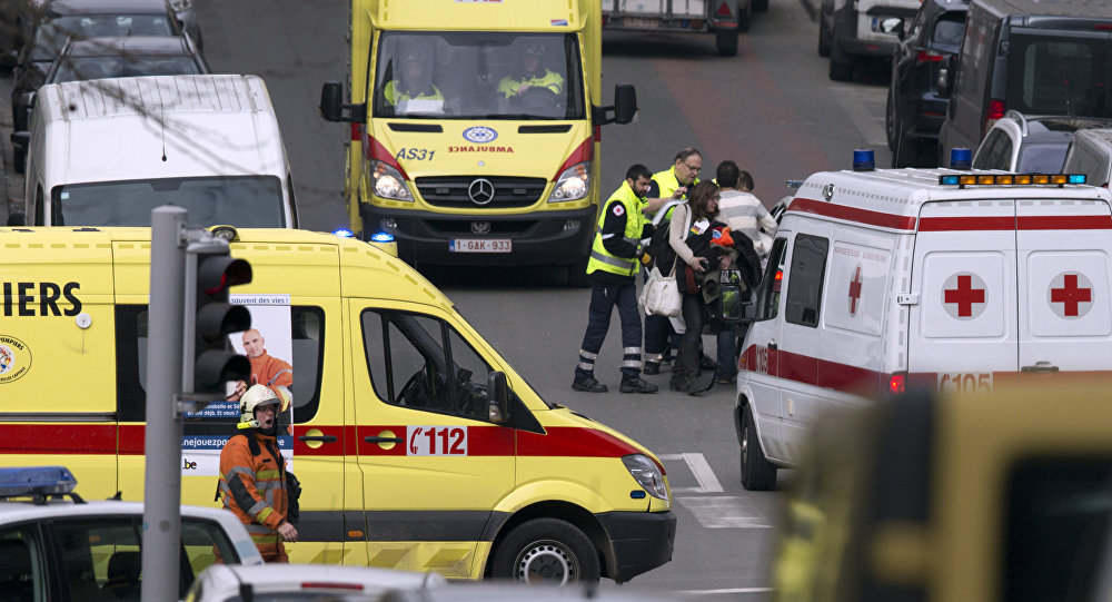 A woman is evacuated by emergency services after a explosion in a main metro station in Brussels on Tuesday, March 22, 2016